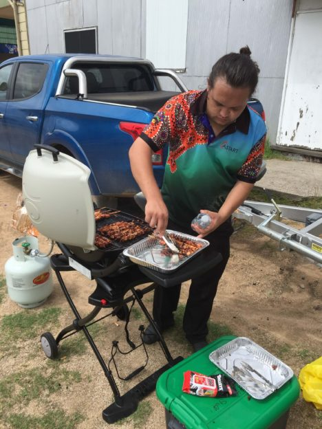 Staff Preparing A BBQ Lunch During A Community Visit
