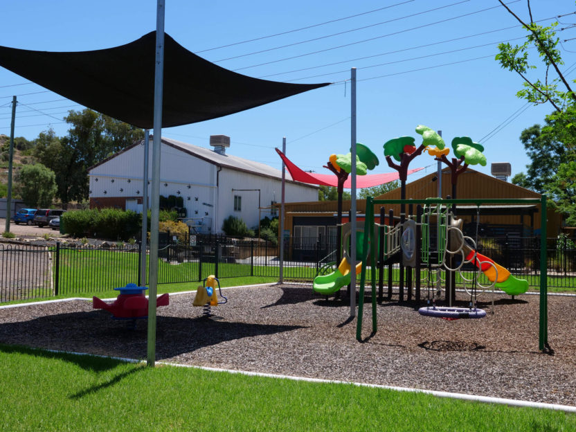 Private play area and community building in background